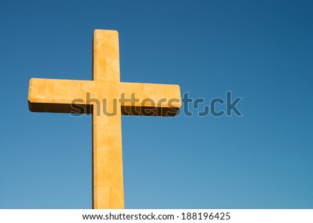 A Christian cross against the background of perfectly blue sky - stock photo