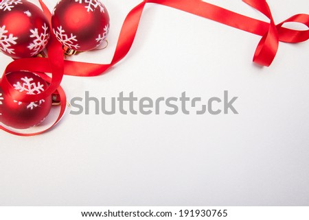 A Christmas balls and a red ribbon on a white background - stock photo