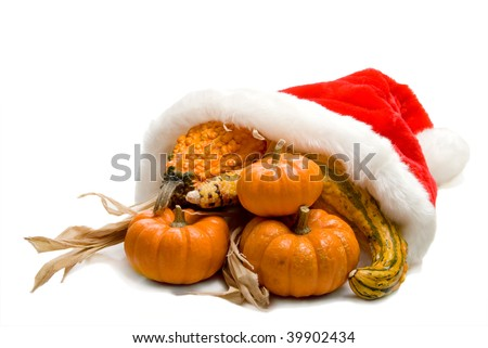 A Christmas Cornucopia with a Santa hat and fresh vegetables. - stock photo