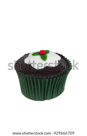 A christmas cupcake isolated on a white background - stock photo