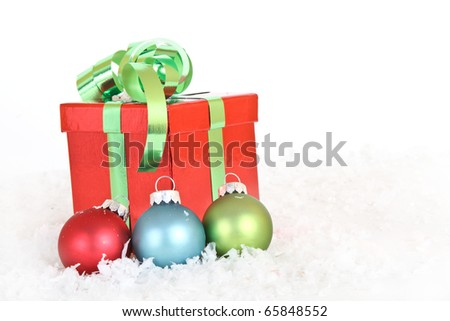 A christmas gift with snow and ornaments