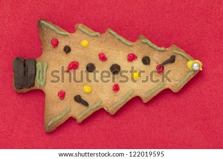 A christmas gingerbread cookie on a red table napkin