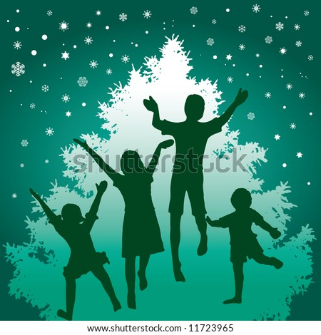 A Christmas motif where kids dance in front of a Christmas tree with snow in the air - stock photo