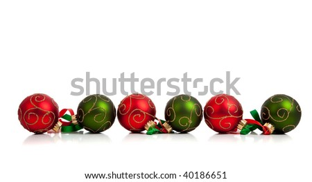 A christmas ornament border with red and green glittered baubles with red and green ribbon on a white background - stock photo