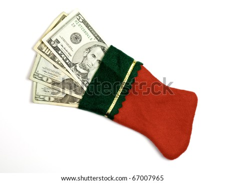 A Christmas stocking filled with a gift money - stock photo