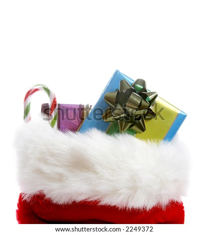 A christmas stocking overflowing with gifts - stock photo