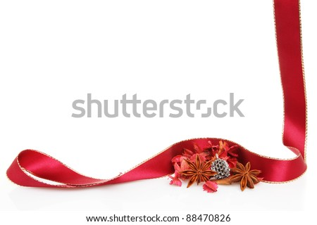 A Christmas themed frame or border of a red and gold bauble, ribbon and a fresh holly sprig, white copy space in center - stock photo