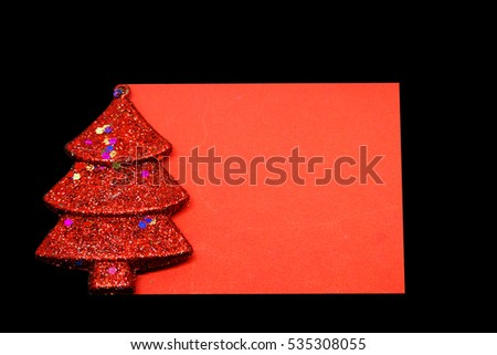 A Christmas tree with a blank sheet on black background