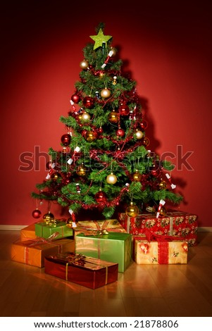 A christmas tree with a star and presents under tree - stock photo
