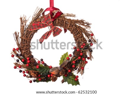A Christmas wreath decoration for hanging on the front door against a white background - stock photo