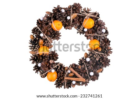 A christmas wreath made of pine cones, acorns and mandarins. Elegant, stylish and beautiful. Isolated on white. - stock photo