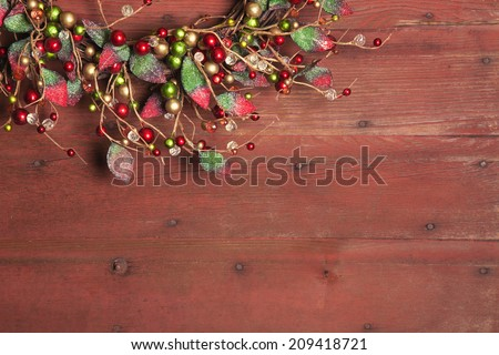 A Christmas wreath on red grunge wood background - stock photo