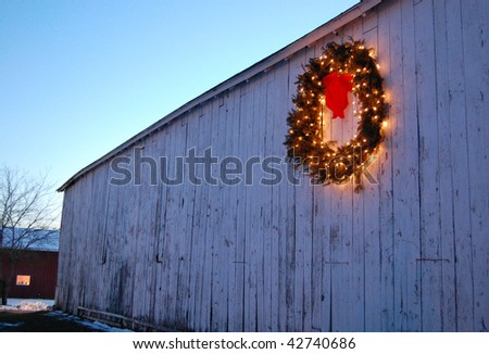 A Christmas wreath on the side of an old barn in a rural area of Connecticut