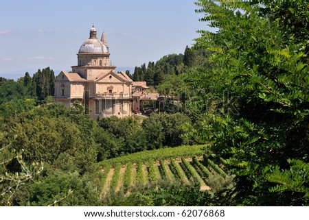 A church behind a vineyard in Tuscany