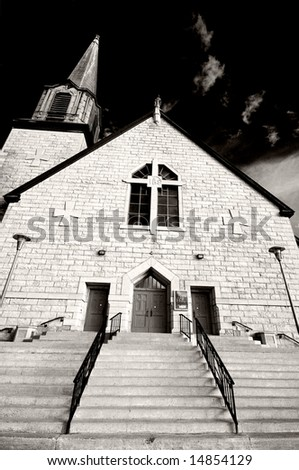 A church caught in dramatic light in black and white.