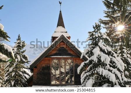 A church in alpine village - stock photo