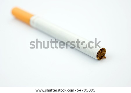 A cigarette with filter isolated on white.