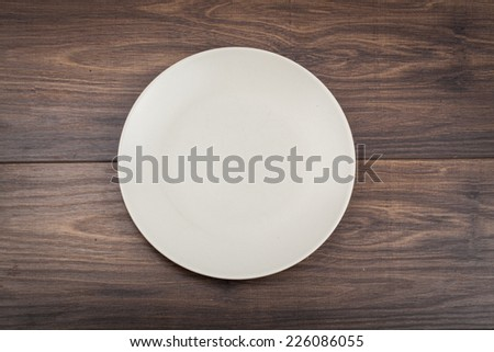 A circle plate on the table  - stock photo