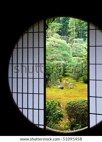 A circular opening frames the view into a famous zen garden at Tofukuji Temple in Kyoto, Japan