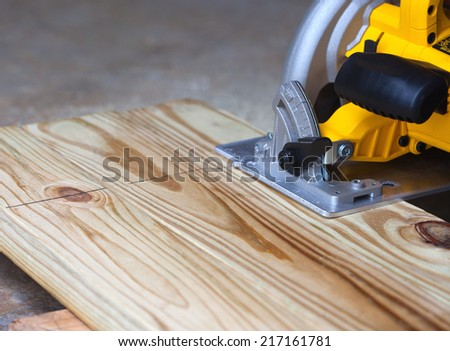 A circular saw is used to cut a two-by-six - stock photo