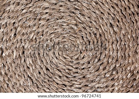 A circular woven reed rug - stock photo