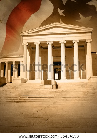 A city courthouse law building with pillar columns and stairs. An American flag is in the background. Can represent law, justice or legislation. There is a gold rustic saturation and texture.
