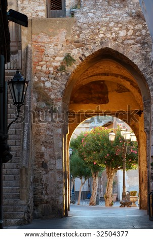 A city gate leading into Taormina, Sicily, captured just after sunrise