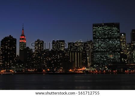 A city landscape lit up at night. - stock photo