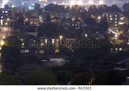 A city suburb at night from above with lights. - stock photo