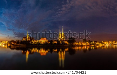 A cityscape cathedral, river Odra. Wroclaw, Poland, at dusk. Panorama. - stock photo