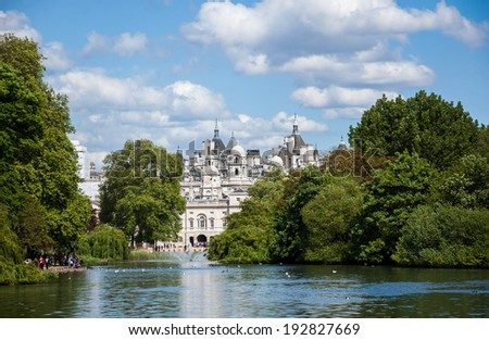 A cityscape view through the Serpentine lake in Hyde Park, Kensington Gardens in sunny day. London UK. - stock photo