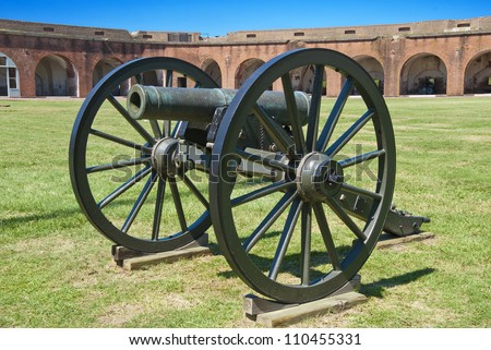 A civil war era brass field howitzer at Fort Pulaski on the Savannah River, Georgia. - stock photo