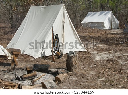 A Civil War Era Infantry Encampment in the woods. - stock photo