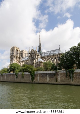 A classic, almost archetypal view of the Notre Dame and Ile de la CitŽ, seen from across the river Seine in Paris. The cathedral is basking in the sunlight - stock photo