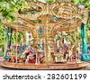 A classic and colorful old merry go round in Cannes, France - stock photo