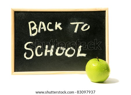 "a classic black chalk board with ""back to school"" in chalk and a green granny smith apple. isolated on white with room for your text"