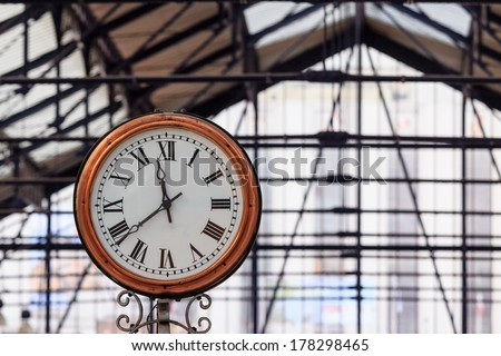A classic clock with roman digits in London's underground station Earls court - stock photo