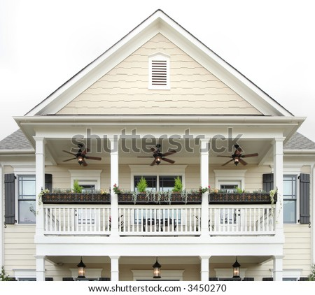 A classic deep South style wood frame home.  Focus on the balcony area. - stock photo