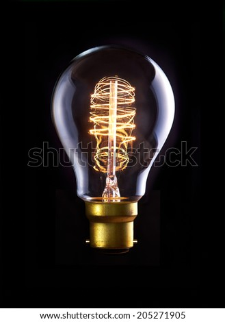 A classic Edison bulb with a loop filament. Switched On. - stock photo