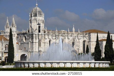 A classic European Monastery with a beautiful fountain in front of it