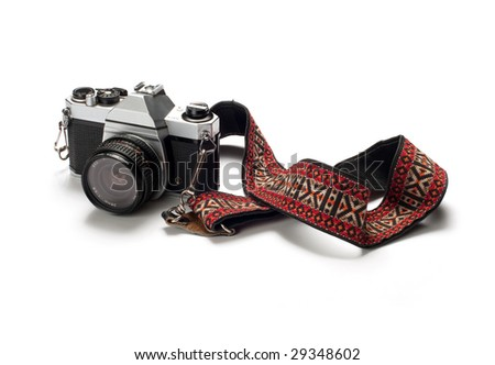 A classic 35mm film camera isolated on white.