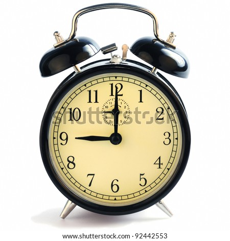 A classic old-fashioned alarm clock showing nine o'clock.