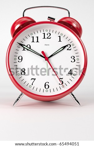 A classic red alarm clock on white background - stock photo