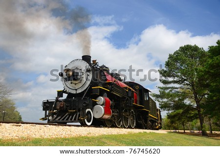 A classic representative of the steam powered locomotive engine era. - stock photo