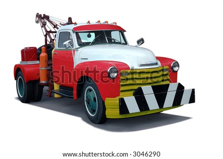 A classic 1960's tow truck (vintage) - stock photo