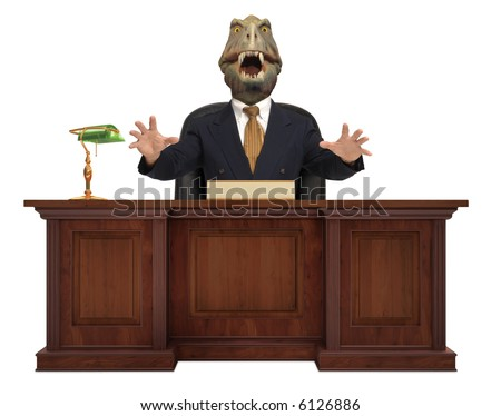 A classic styled corporate desk with with a Tyrannosaurus Rex sitting behind it wearing a suit and tie on white background - stock photo