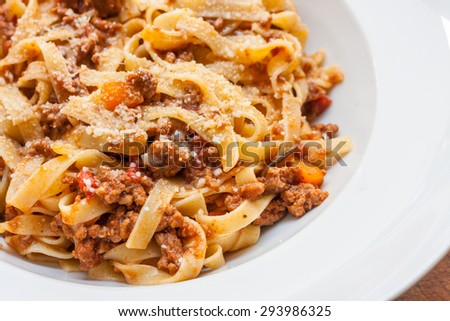 A classic traditional Italian dish, ragu all bolognese, with tagliatelle in a white bowl