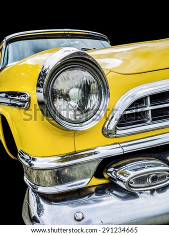 A classic US car from the 50's with characteristic chromed body parts and details. Classic! - stock photo