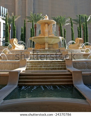 A classic water fountain with steps of flowing water - stock photo