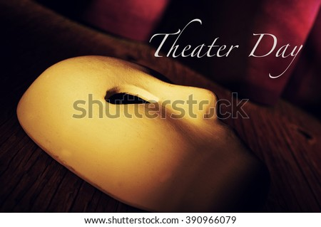 a classical theatrical mask on a stage with an elegant act curtain in the background and the text theater day - stock photo